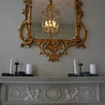 Folkform candle holders contrasting with the 18th century architecture