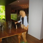 wooden lady with hand bag in the hotel restaurant