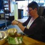 One visitor gets to try to whip the eggs inside the silver bowl