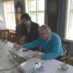 Miki Futugawa and Edvard Fleetwood trying to make all the technology to work before the board meeting