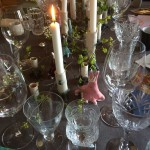 Detail with small ceramic objects decorating the tables