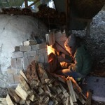 Students taking turn, adding to the fire every five minutes for four days and nights in the anagram oven